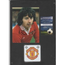 Signed picture of Manchester United footballer Mickey Thomas.